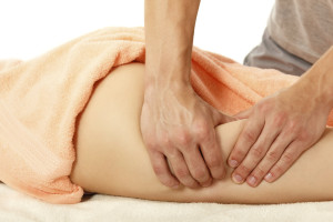 masseur makes anti-cellulite massage young woman